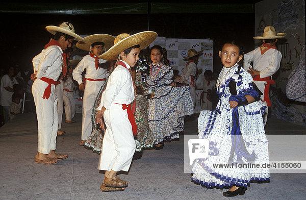 Children wearing folk dresses dancing traditional folklore dances  Guadalajara  Jalisco  Mexico