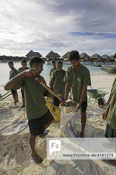 Maldivians fortify the sandy beaches as a protection against Tsunamis and currents  Maldives