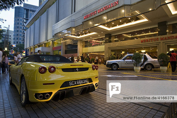 Yellow Ferrari parked in front of the Meritus Mandarin Hotel  Orchard Road  Singapore  Southeast Asia