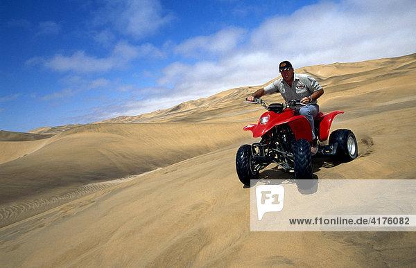 ATV or quad in the dunes at Swakopmund  Namib Desert  Namibia  Africa