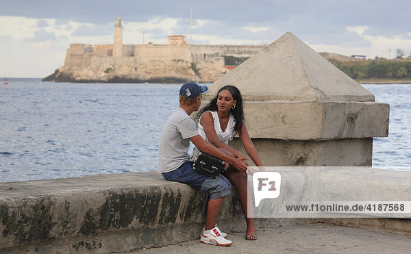 Local couple  promenade  Malecón  Havana  Cuba  Caribbean
