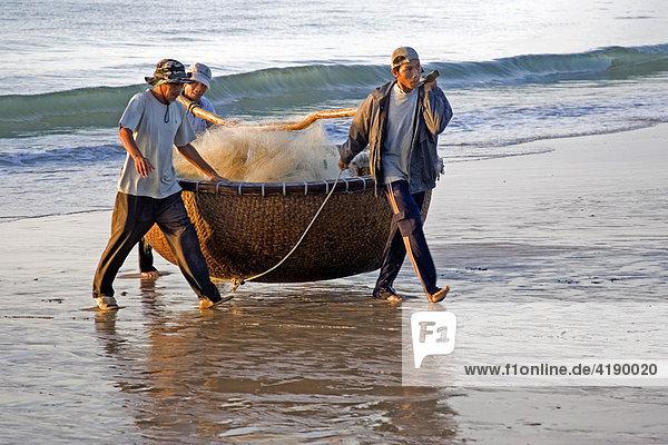 Viatnamese fishermen and their swimming basket at the beach of Mui Ne  Vietnam  Asia