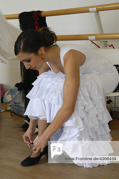 Flamenco dancer Triana putting on her shoes  Conservatorio de Danza  Sevilla  Andalusia  Spain  Europe