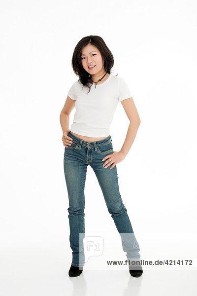 Beautiful Asian woman posing on a white background