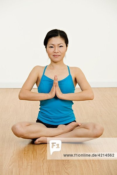 Beautiful Asian woman practicing Yoga