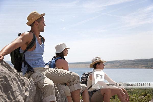 Hikers resting on coastal path