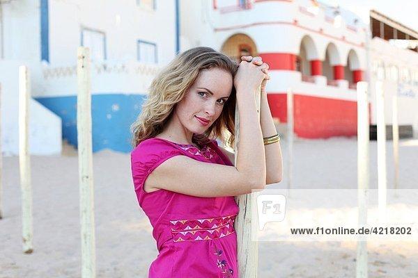 Woman poses in Carvoeiro beach  Algarve  Portugal