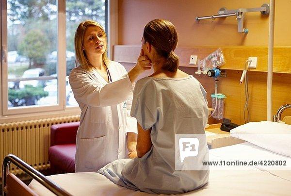 Doctor with patient in a hospital room. Hospital Policlinica Gipuzkoa  San Sebastian  Donostia  Euskadi  Spain