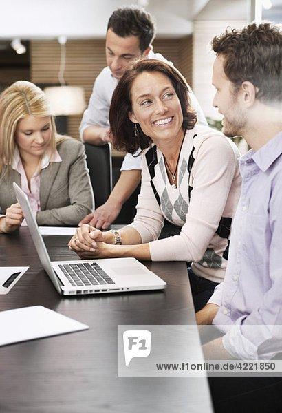 Men and women in meeting