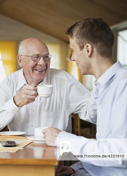Happy relatives drinking coffee