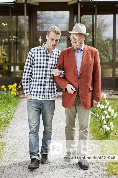 Man helping senior
