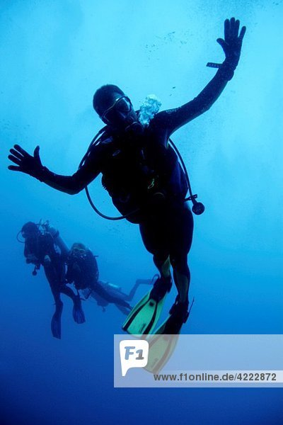 Maldives rasdhoo atoll madivaru blue a scuba diver making faces