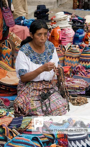 Indigenous woman selling her wears in the market  Antigua  Guatemala