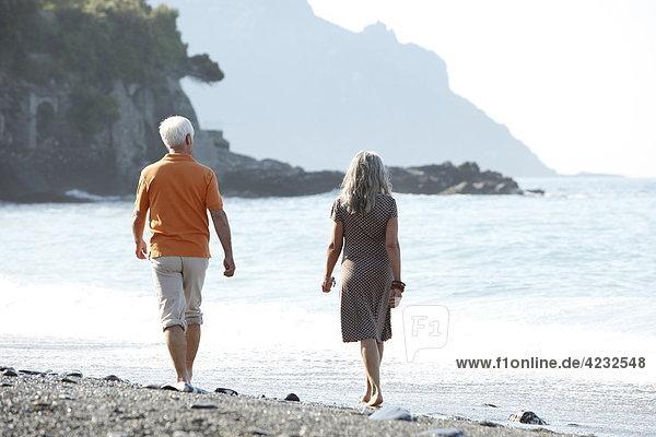 Senior couple walking on beach  Italy  Sori