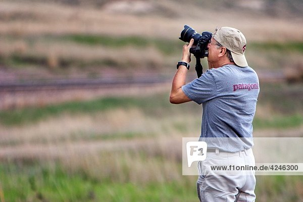 Professional photographer Jim Reed takes a photo  May 29  2010