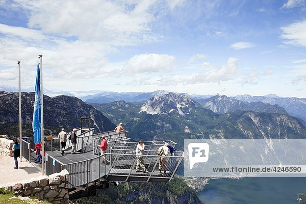 Obertraun  Salzkammergut  Austria  Europe People on 5fingers viewing platform on Krippenstein mountain at the Dachstein World Heritage site with high view to Hallstattersee lake