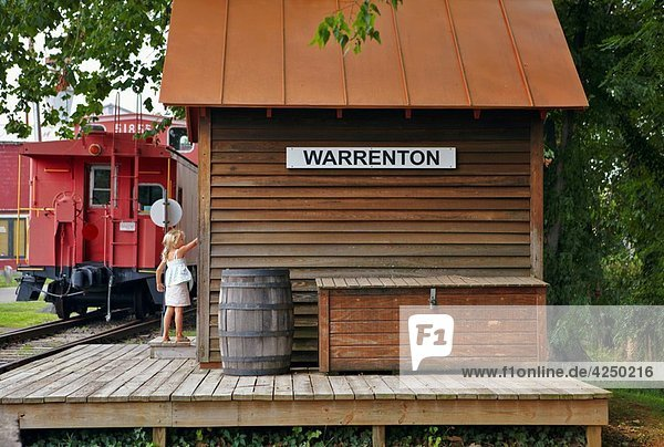 A young girl at the door of the restored platform of the Warrenton Branch Depot  Warrenton  Virginia