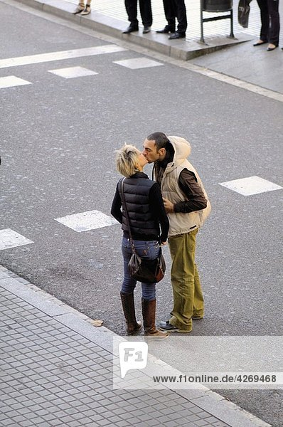 Couple kissing  Ramblas  Barcelona  Catalonia  Spain