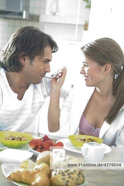 woman feeding men