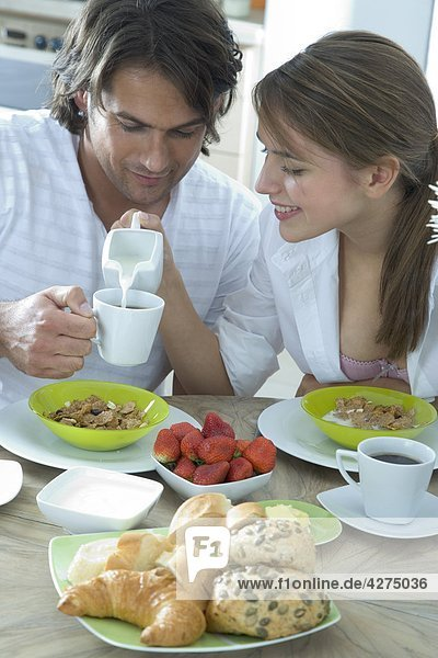 couple eating breakfast in kitchen