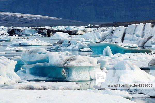 Iceland  Jokulsarlon glacier  icebergs floating on water.