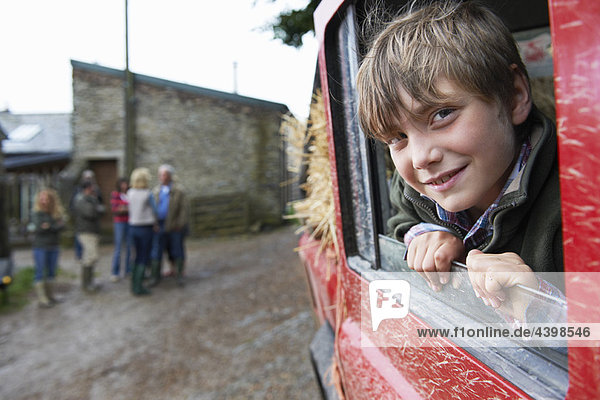Boy looking out of 4x4 landrover window