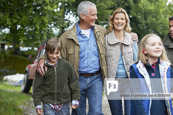 Family walking on farm