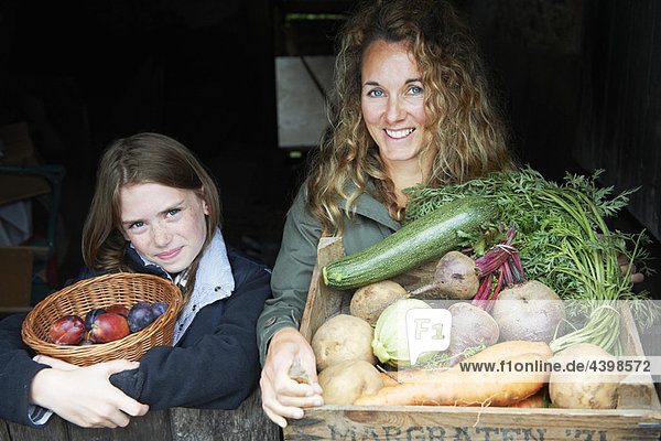 Mother and daughter with vegetables Mother and daughter with vegetables