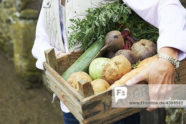 Grandmother with vegetables