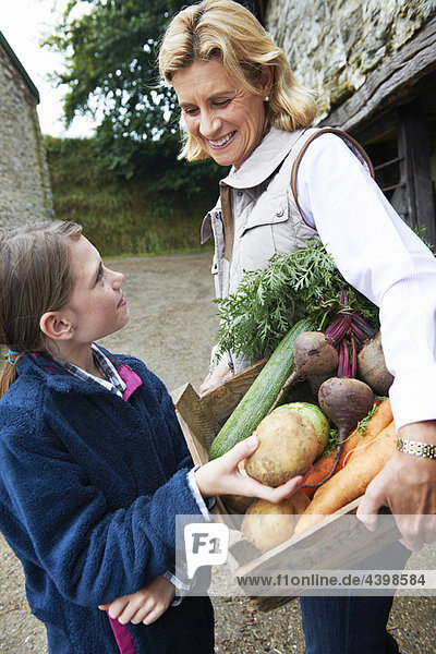Grandmother and girl with vegetables