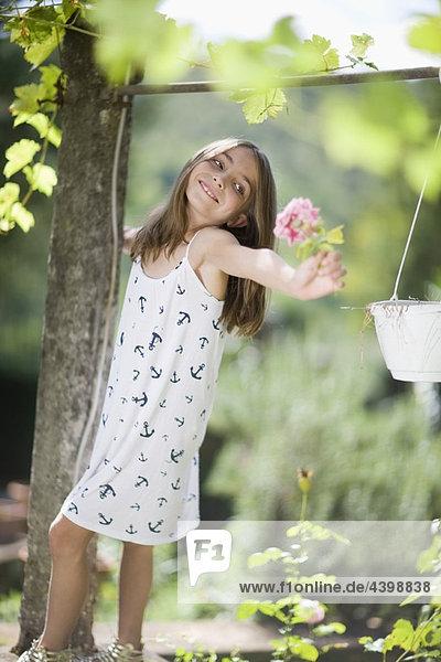 Little girl holding a rose