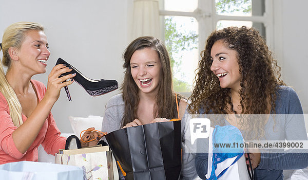 Young women share shopping spree at home