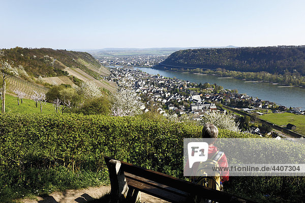 Woman sitting on bench and looking at view