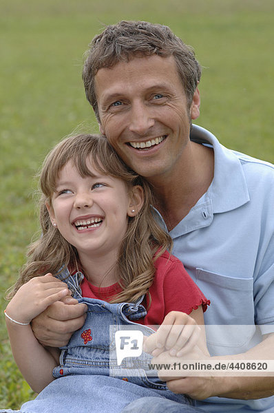 Father and daughter playing in the garden  portrait  smiling