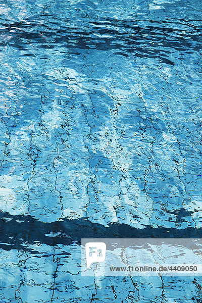 Water rippling in swimming pool  close up