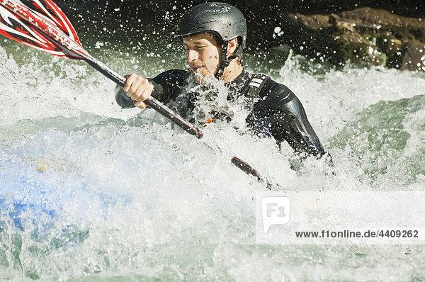 Austria  Salzburger Land  Man kayaking in lammer river