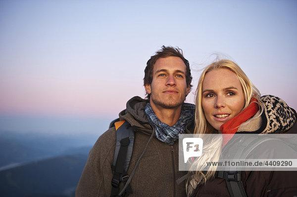 Austria  Steiermark  Dachstein  Couple smiling  close-up