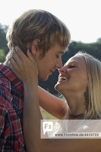Germany  Dortmund  Young couple about to kiss  close up