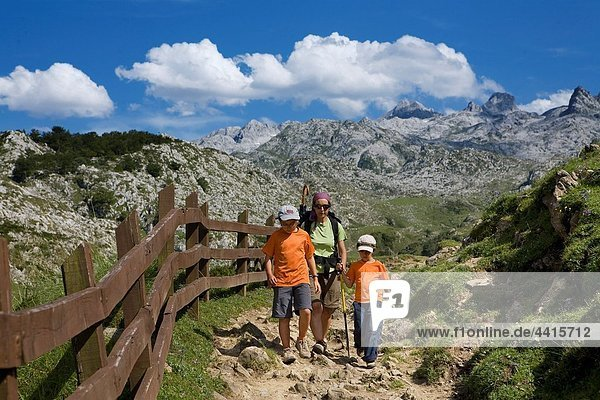 Family practice mountaineering along a route  in the Cornion massif  near to the Covadonga Lakes  in the Picos de Europa National Park  Asturias  Spain