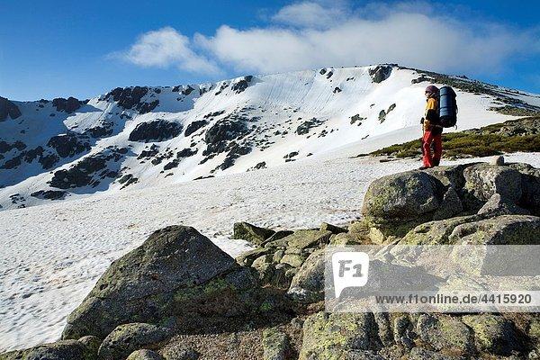 Woman practicing mountaineering in the Sierra de Béjar Natural Park  in the provincial boundary between Salamanca and Avila  Biosphere Reserve of Sierra de Béjar and Francia