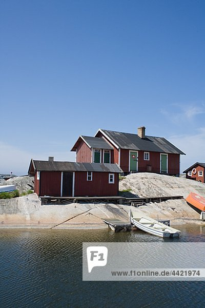 Cottages on rock with boats