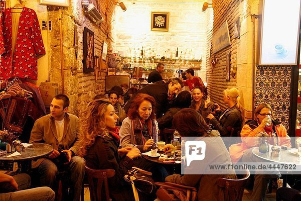 People sitting at a cafe in the Grand Bazaar  Istanbul  Turkey