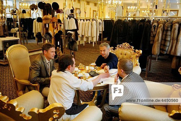 Business meeting at the exclusive Lena boutique which sells sable fur coat  St Petersburg  Russia