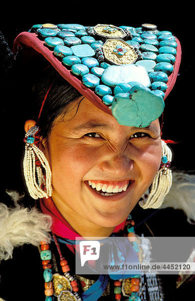 Ladahki woman wearing traditional hat. India