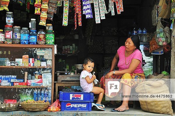 The woman with daughter keeping the shop
