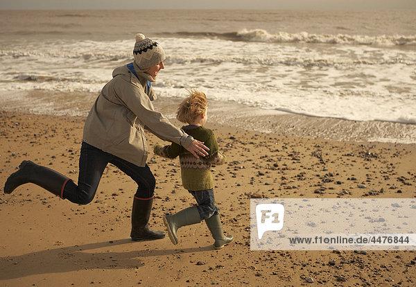 Frau  Strand  Junge - Person  rennen  spielen