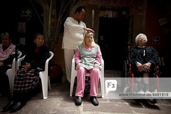 A woman receives Reiki in Mexico City  November 30  2010 Reiki is a spiritual practice developed in 1922 by Japanese Buddhist Mikao Usui It uses a technique commonly called palm healing  using hands as a form of complementary and alternative medicine  c