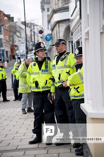 Police officers at student protest against education cuts  Aberystwyth Wales UK