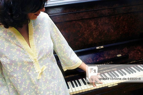 A woman pressing a Bechstein piano key