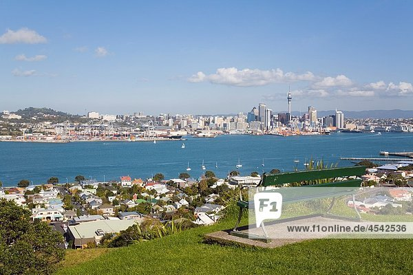 Devonport  North Shore  Auckland  North Island  New Zealand Bench seat on Mount Victoria with view to Auckland eastern city skyline across Waitemata Harbour